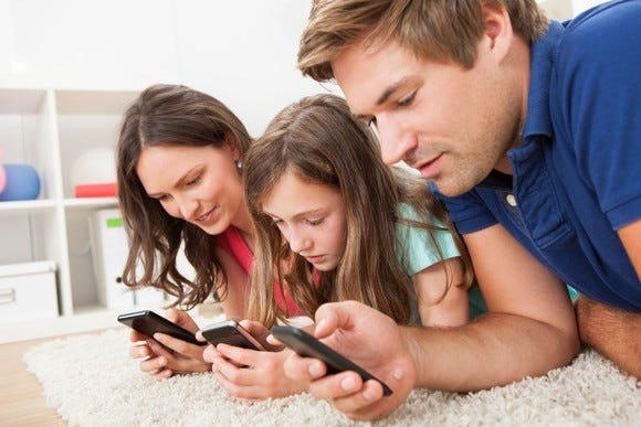 parents-and-daughter-on-smartphones-cell