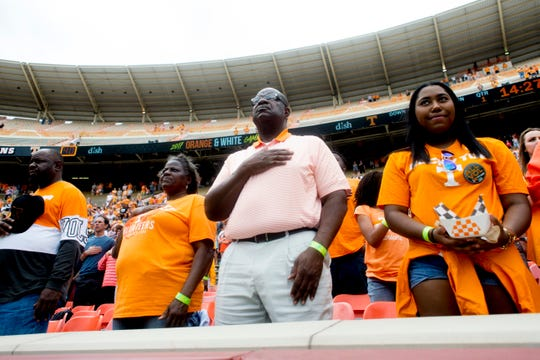 Fans sing the national anthem during the Orange & White Game at Neyland Stadium in Knoxville, Tennessee on Saturday, April 22, 2017.