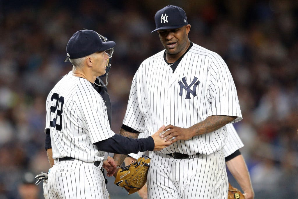 Holliday's heroics lift Yankees past Orioles