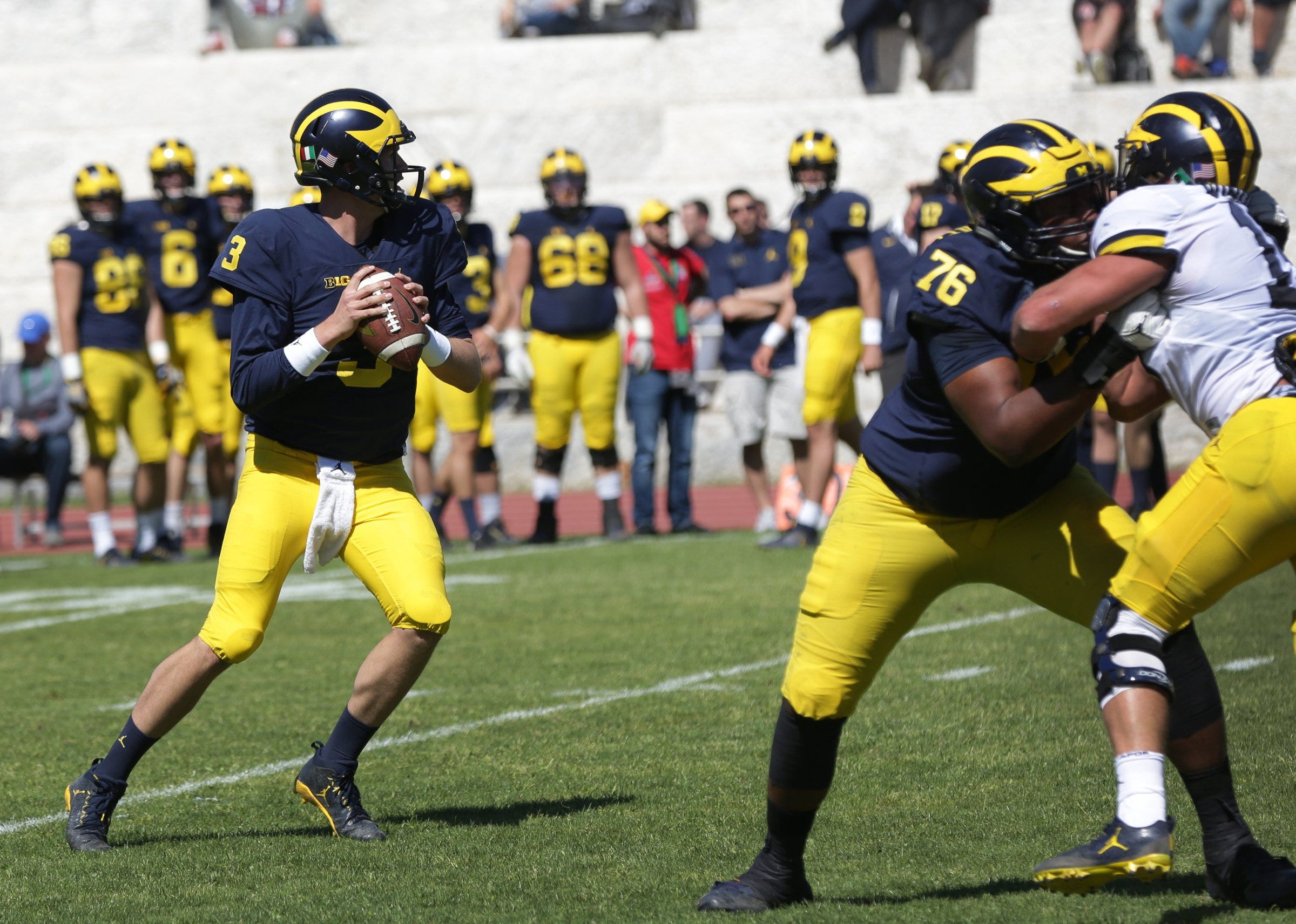 Michigan coach Jim Harbaugh breaks down quarterback race, wishes they could all start