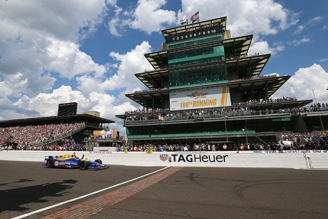 IndyCar driver Alexander Rossi crosses the finish line to win the 100th running of the Indianapolis 500, Indianapolis Motor Speedway, Sunday, May 29, 2016.
