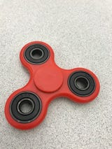 The Fidget Spinner was marketed as something to keep your hands busy and relieve stress.
