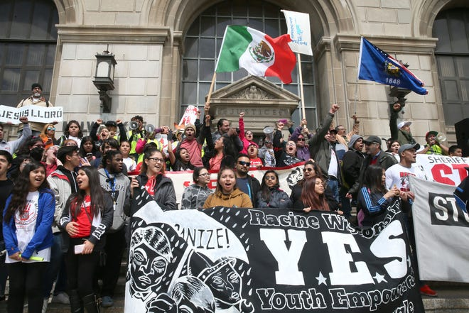 Marchers gathered on the steps of the Milwaukee County Courthouse during a 2017 May Day rally organized by Voces de la Frontera that brought attention to immigrants rights and protested policies endorsed by former Sheriff David A. Clarke Jr. and President Donald Trump.