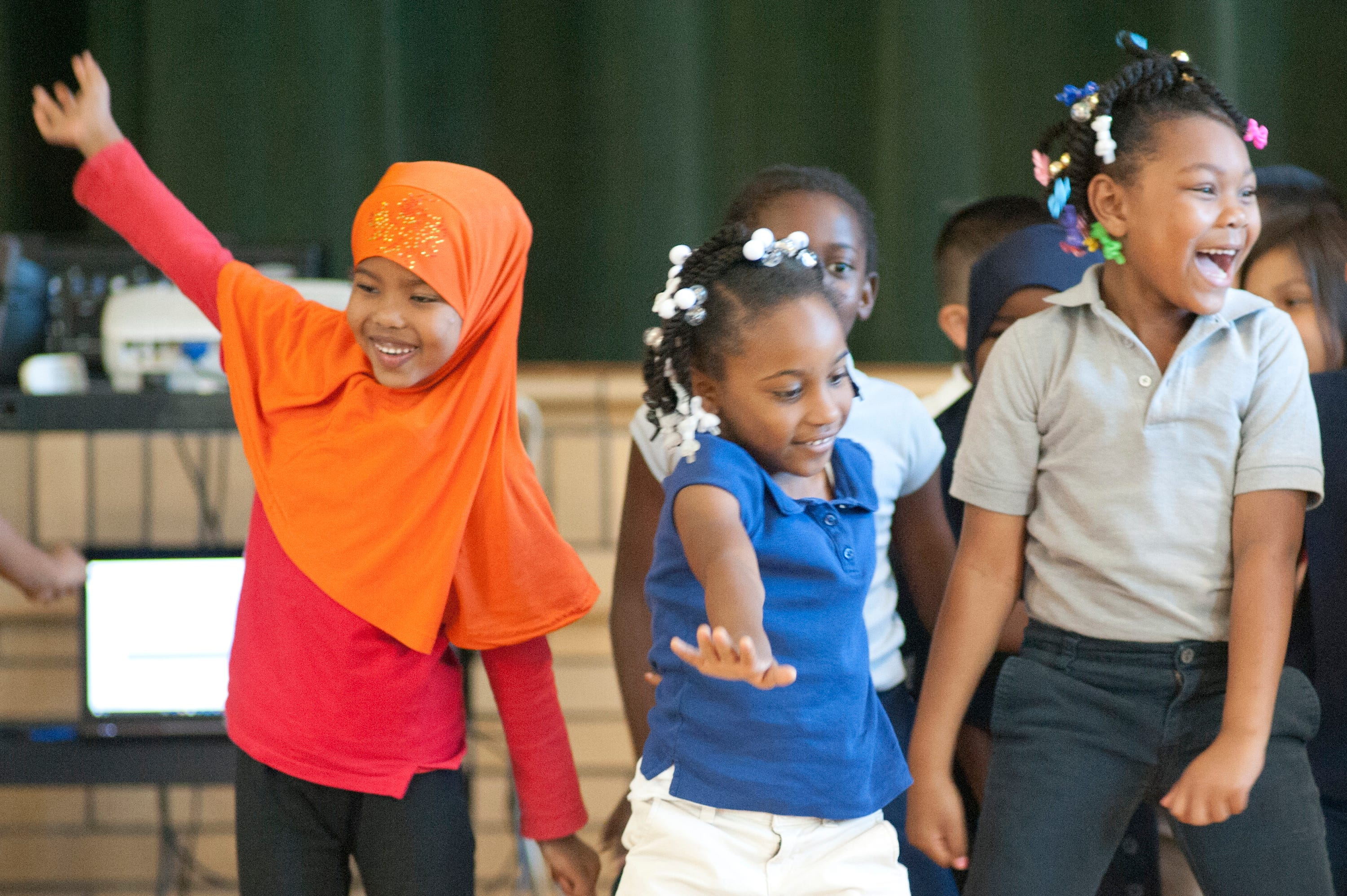 Frayser Elementary School first graders dance to encourage the school's third, fourth and fifth graders to perform well during the 2017  KPREP tests. From left, Naiomo Omar, D'Asia Keen and Jada Porter. May 3, 2017.