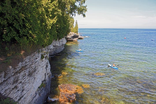 Kayakers explore Cave Point County Park south of Jacksonport in Door County.