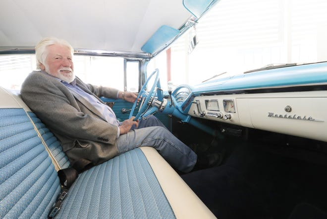 """William """"Red"""" Lewis, owner of the Automobile Gallery, sits in a 1956 Mercury Montclair in the gallery on Adams Street in Green Bay, in 2017,  the year he recived the  Rotary Club of Green Bay's Free Enterprise Award."""