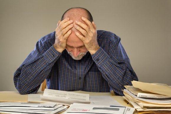 frustrated-man-looking-at-bills_large.jp