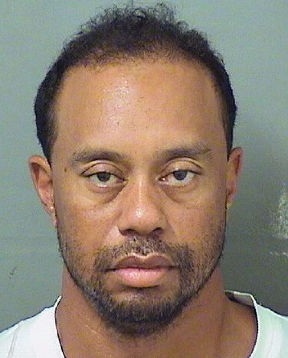 Latest photo of Tiger Woods a stunning contrast to one we