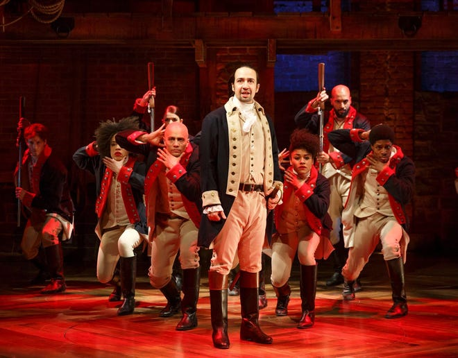 'Hamilton' creator Lin-Manuel Miranda (center) in a scene from the megahit Broadway musical.