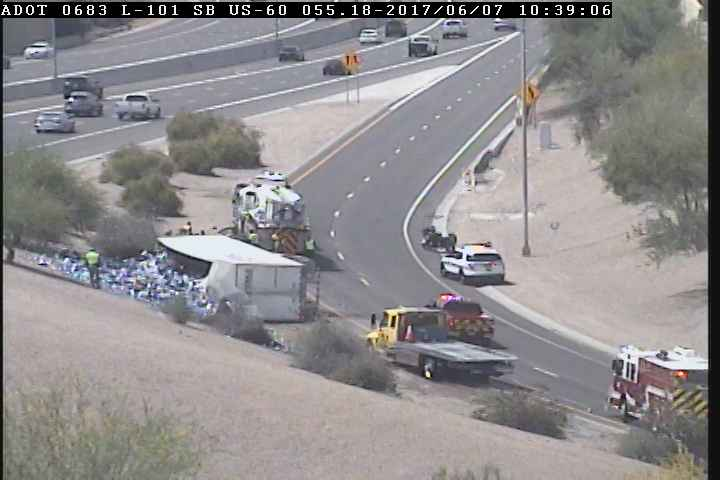 Truck full of Bud Light tips over between US-60 and Loop 101