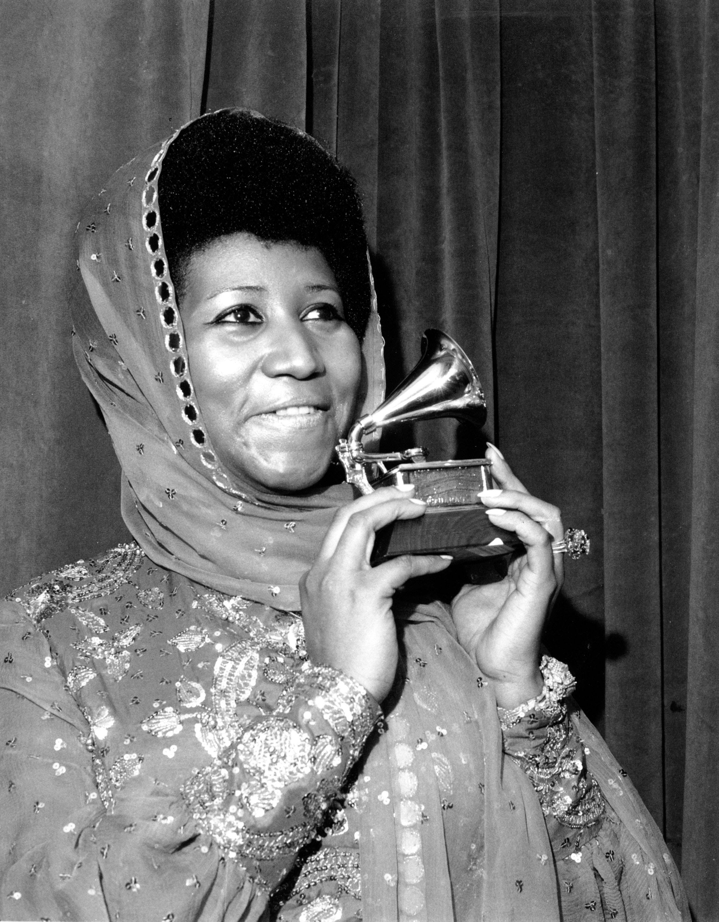 """Aretha Franklin poses with her Grammy Award at the 17th Annual Grammy Award presentation in New York on March 3, 1975. The award is for her performance in """"Ain't Nothing Like the Real Thing."""" Franklin has won every Grammy Award for """"Best Rhythm and Blues Performance, Female"""" since this category was created in 1968."""