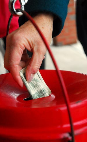 Matthew Berry/Gannett Ohio Barbara Shauck of Pataskala drops money into a Salvation Army collection kettle in 2008 outside the Ross Granville IGA. Barbara Shauck, from Pataskala, drops money into a Salvation Army collection kettle in 2008, outside the Ross Granville IGA.