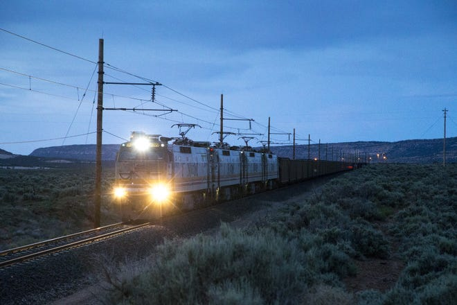 The Black Mesa and Lake Powell Railroad electrified train (BLKM) starts its 78-mile trip from the Kayenta Mine load-out silos, May 30, 2017, to the Navajo Generating Station. The train had 83 cars, each carrying 100 tons of coal.