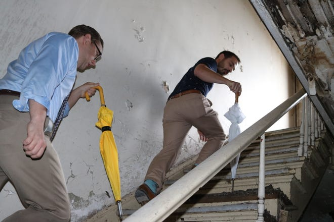 Larry Hartlaub, Ottawa County auditor, and Mark Messa, director of the Ottawa County Region Planning Commission, check out the third floor of the blighted building at 131 Madison Street, which will be demolished by the Land Bank later this month.