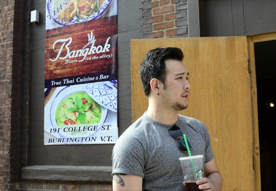 Bobby Chompupong stands by the entrance to his restaurant, Bangkok Bistro off of the Church Street Marketplace in Burlington on Wednesday, July 12, 2017.