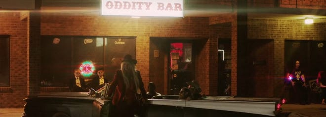 """Kesha and her band as seen in her new music video for the song """"Woman,"""" which was shot at Wilmington's Oddity Bar last month. The song will appear on her next album, """"Rainbow,"""" due Aug. 11."""