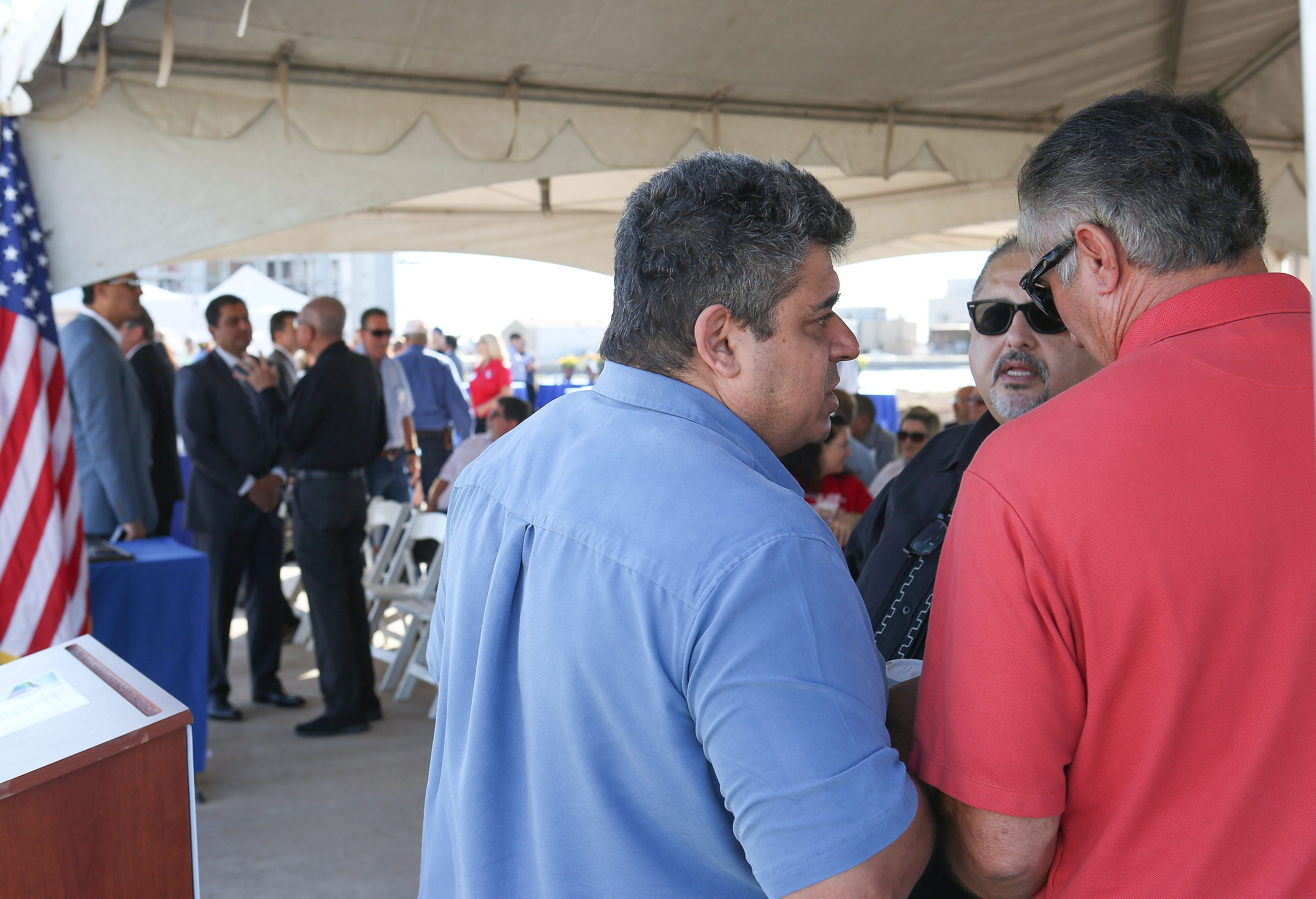 From left: ZGlobal founder Ziad Alaywan, ZGlobal employee Jesse Montaño and former Imperial Irrigation District board member Mike Abatti chat at the dedication ceremony for IID's battery storage project in El Centro, California, on Oct. 26, 2016.