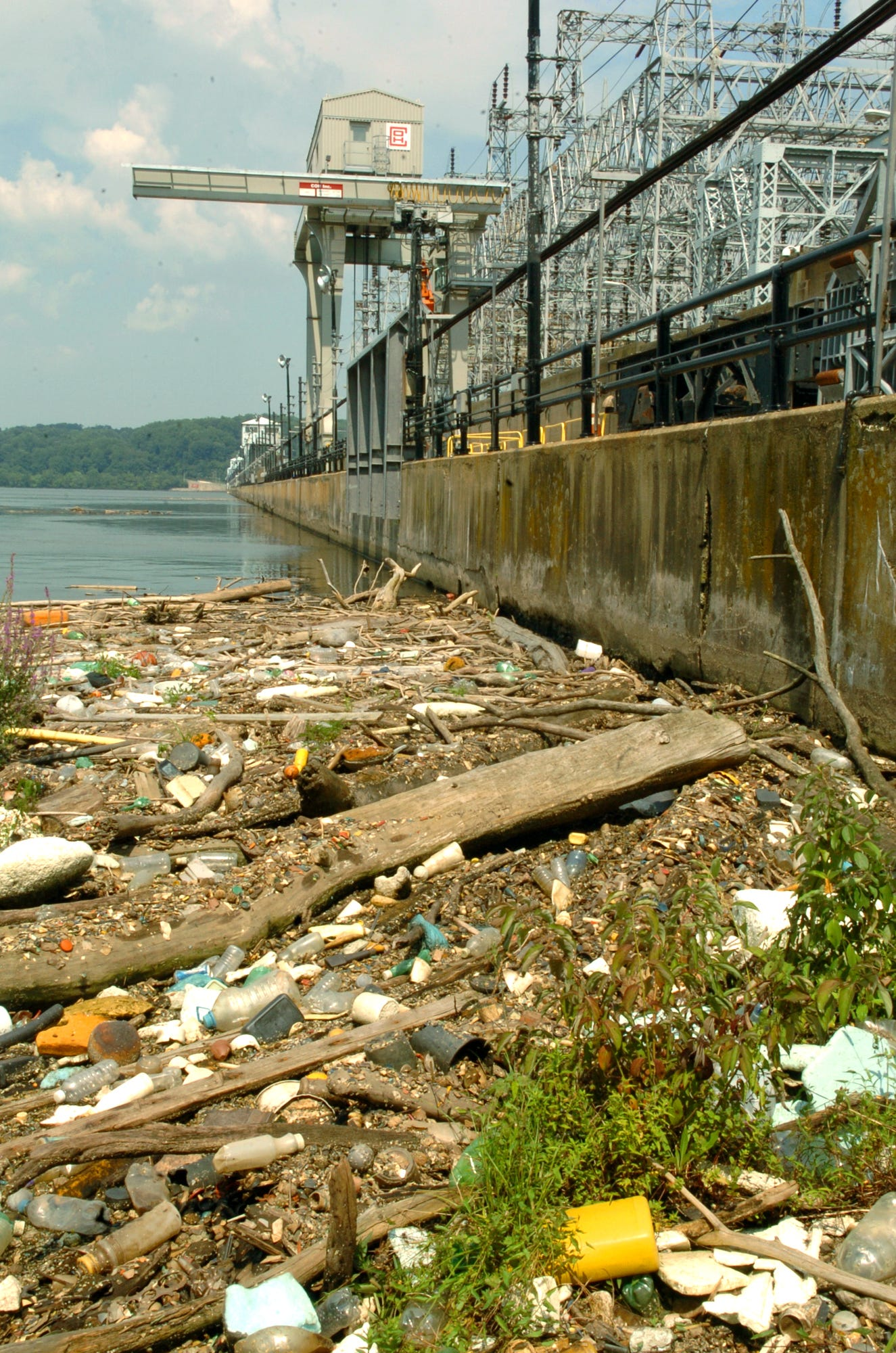 Floating debris piles up alongside the Conowingo dam on the west side of the Susquehanna River in 2009.