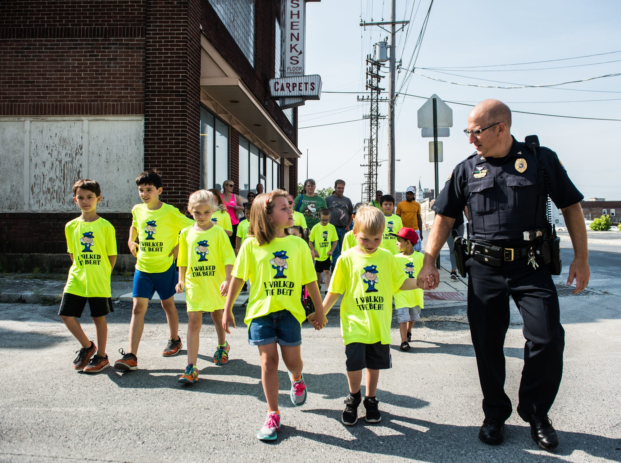 Lebanon City Police Chief Todd Breiner walks with the kids during the second Walk with a Cop event hosted by the City of Lebanon and the Lebanon Valley YMCA on Saturday, July 22, 2017. During the walk Briner went over safety tips when walking through the city.
