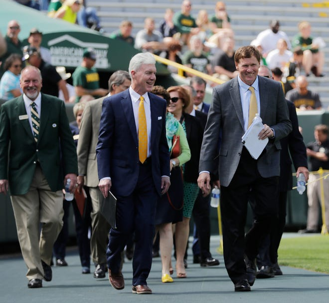 Packers President & CEO Mark Murphy and General Manager Ted Thompson lead the board onto the field at the annual Green Bay Packers shareholders meeting July 24, 2017, at Lambeau Field in Green Bay.
