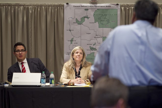 Vice Chairman Jose Herrera and Chair Colleen Coyle Mathis listen to testimony during the Arizona Independent Redistricting Commission meeting Thursday, Sept. 15, 2011, in Phoenix. A newly selected redistricting commission will get to work in 2021.
