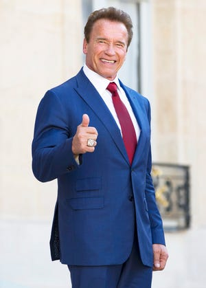 Woohoo! He's giving us a thumbs up after his meeting with French president Emmanuel Macron.