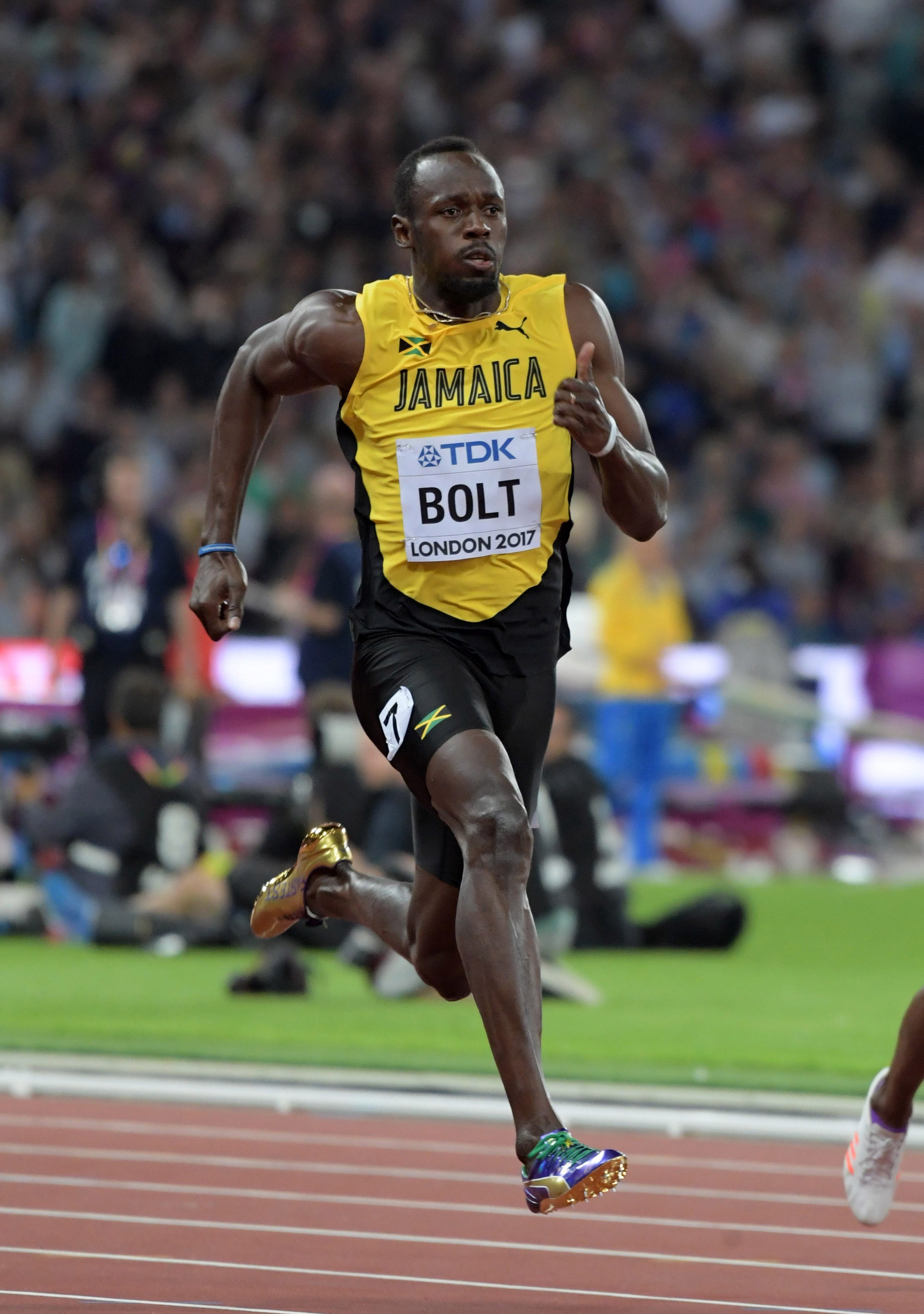 Stunner: Usain Bolt finishes third in the 100 in his final championships