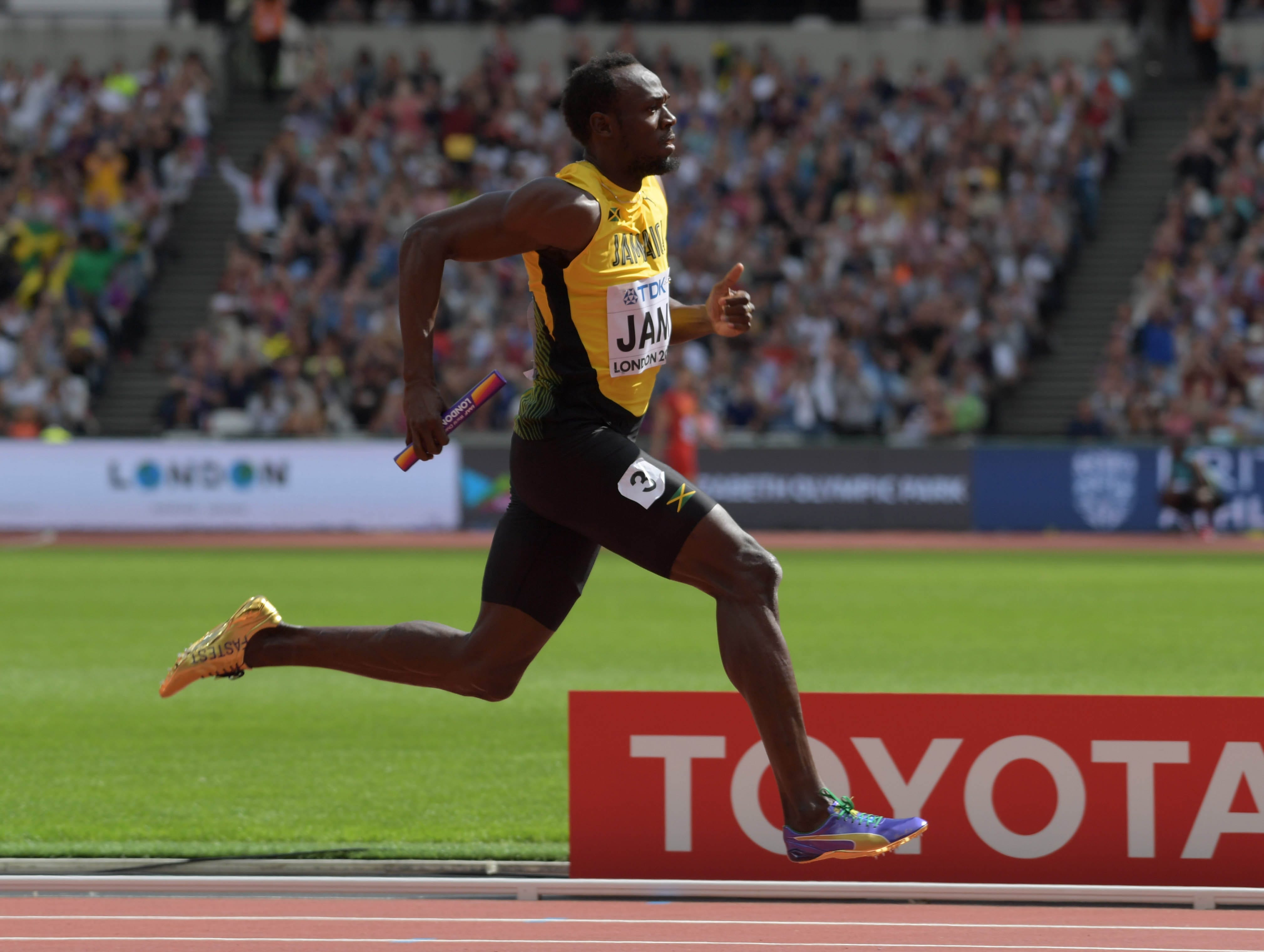 Usain Bolt pulls up hurt in 4x100-meter relay, his final track event