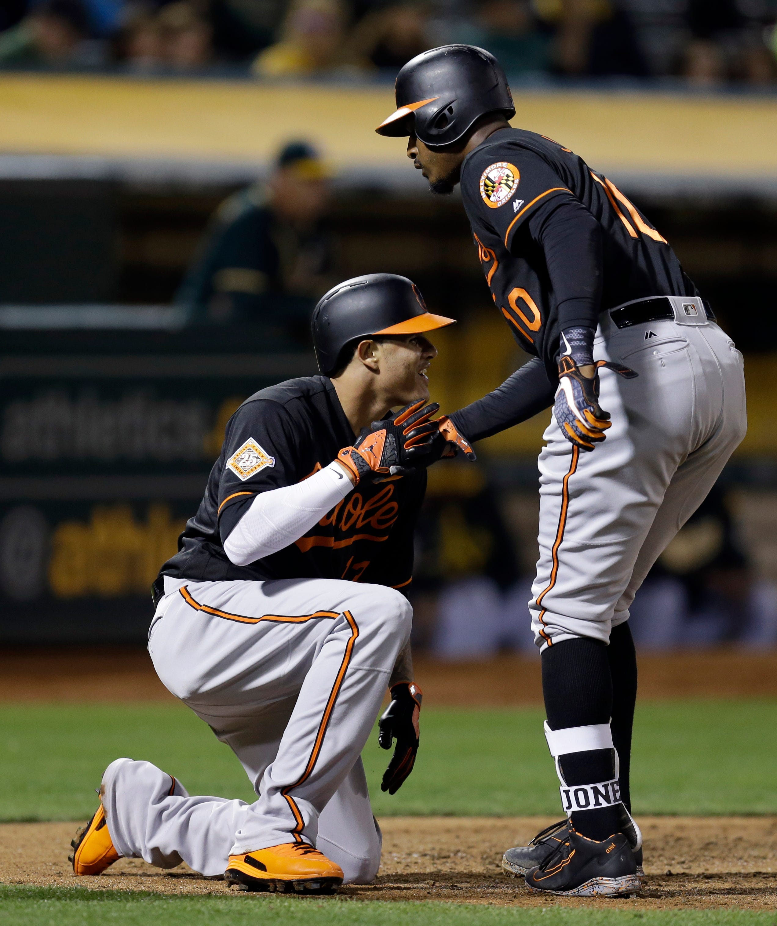 Lowrie's double keys rally as A's top Orioles 5-4