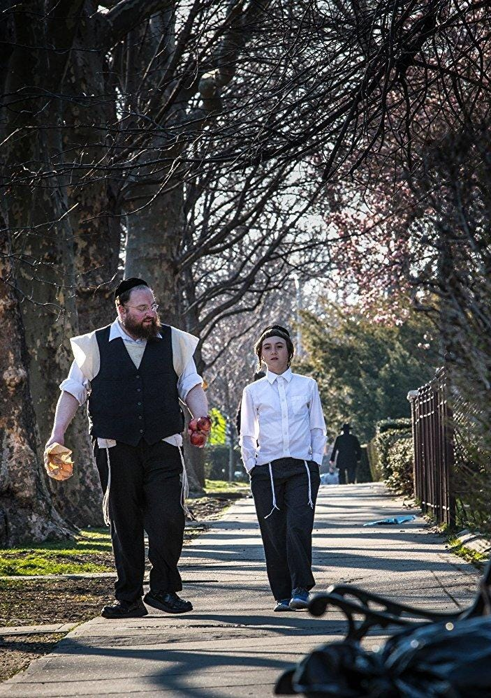 Review: In 'Menashe,' a father and son confront Hasidic tradition