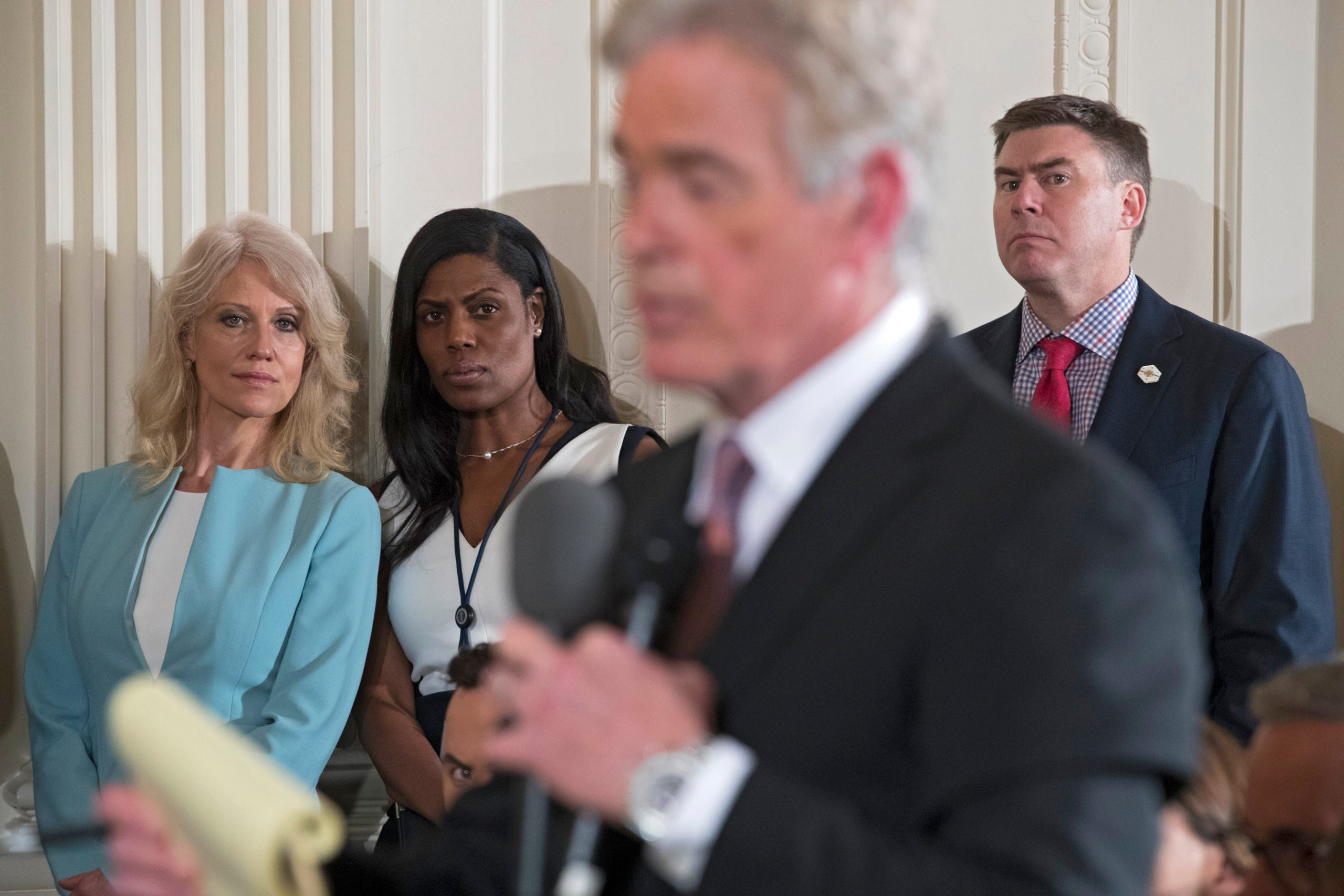 Mike Dubke (R) on May 30, 2017, confirmed his resignation as White House communications director.   Counselor to the US President Kellyanne Conway (L) and Director of Communications for the Office of Public Liaison Omarosa Manigault (2-L) and Dubke listen as a reporter asks a question during a joint press conference in the East Room of the White House in Washington, on April 20, 2017.