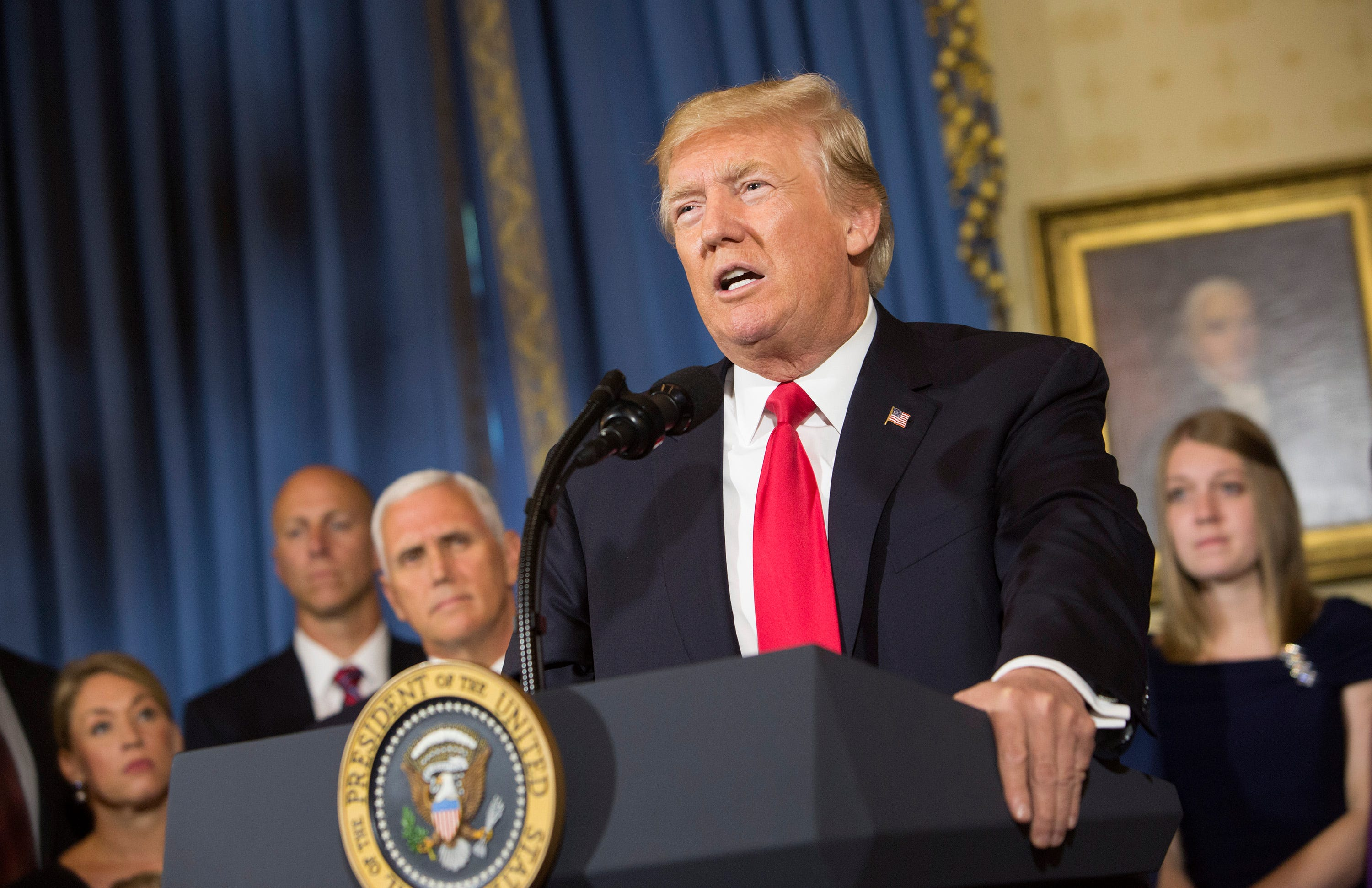 Cautioning against 'hasty' pullout from Afghanistan, Trump clears path for more U.S. troops