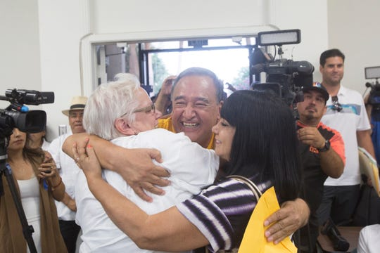 At center, Mario Lazcano, immigrant rights activist, is embraced by fellow activists after the Coachella City Council votes to declare the city a sanctuary city.