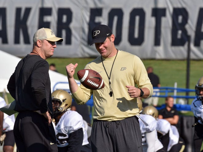 Purdue head coach Jeff Brohm (left) and QB coach/co-offensive coordinator Brian Brohm secured a commitment from Naperville Central quarterback Sam Jackson on Wednesday