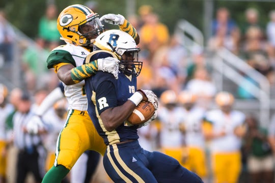 Roberson High School's Deonte Ellison intercepts a pass intended for Crest High School's Jamaud Geter during their game Friday, August 24, 2017.