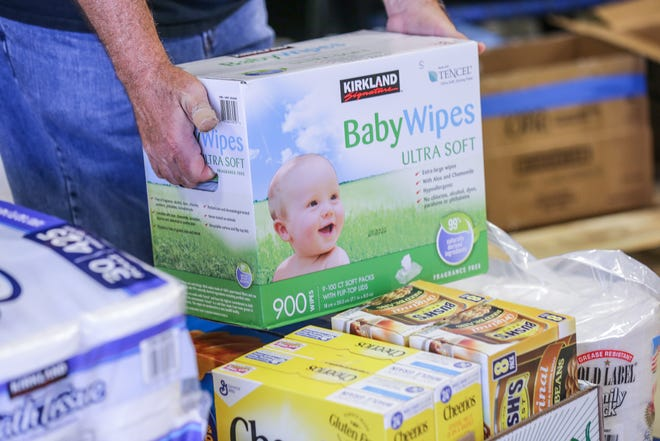 Volunteers unpack donated baby wipes and other items for Hurricane Harvey disaster relief at Midwest Food Bank, 6450 S. Belmont St. Indianapolis, on Monday, August 28, 2017.
