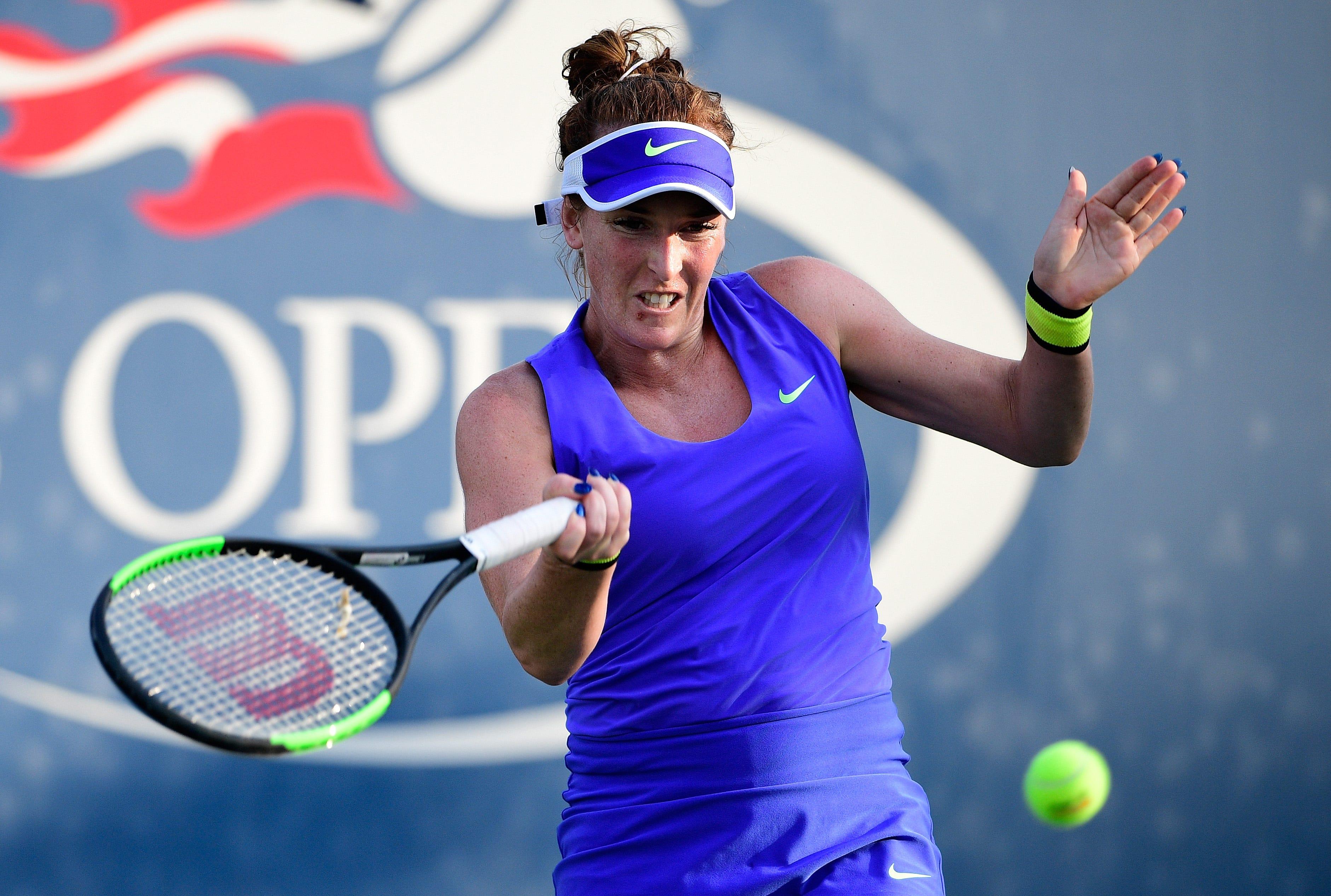 Madison Brengle returns a shot against Kirsten Flipkens at the U.S. Open on Wednesday.