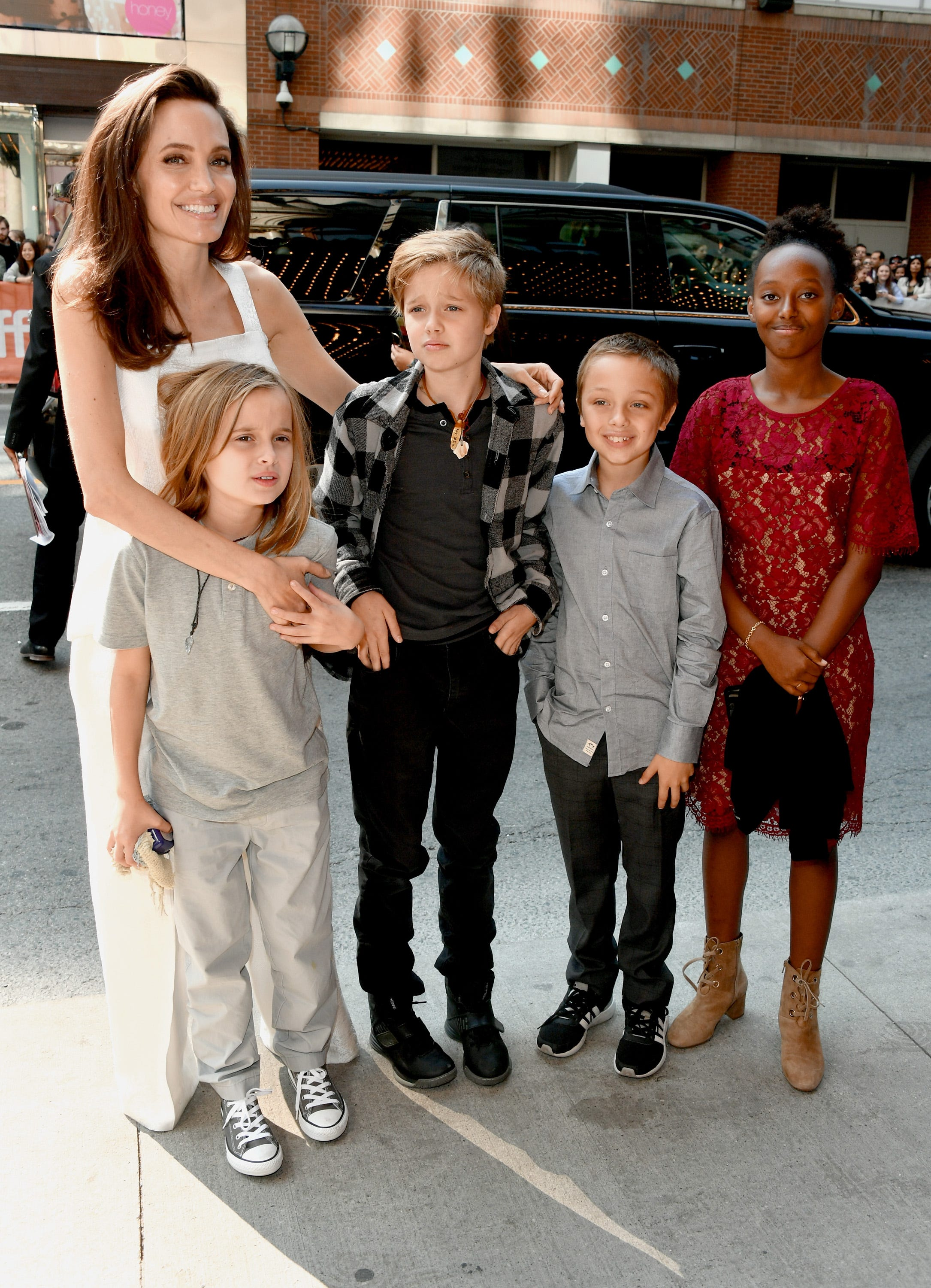Angelina Jolie brings her kids (and her flowy pants) to Toronto Film Festival
