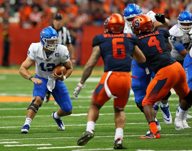 MTSU quarterback Brent Stockstill runs the ball against Syracuse at the Carrier Dome on Saturday.