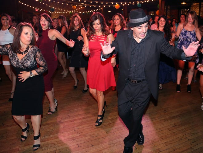 Alejandro Rivera dances to the Music City Latin Orchestra during the The Latin Party at Cannery Ballroom on Saturday. Guests were dressed to dance and celebrate Hispanic Heritage Month. Alejandro Rivera dances to the Music City Latin Orchestra during the #TheLatinParty at Cannery Ballroom in 2016.