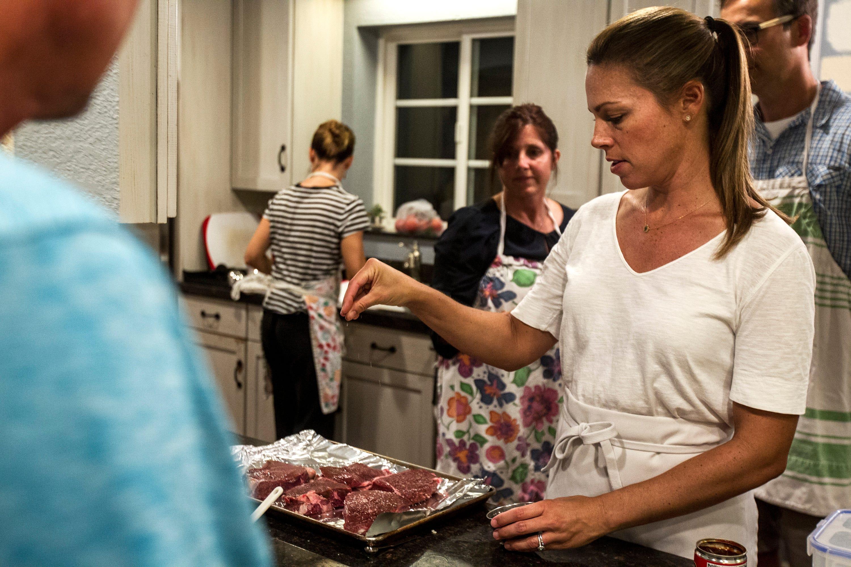 Maggie Norris seasons top sirloin steaks with salt