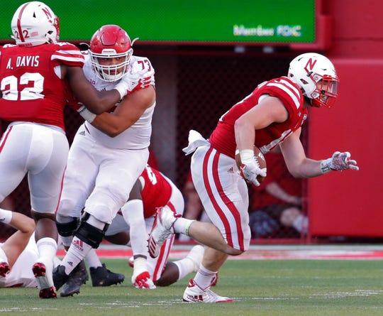 Nebraska linebacker Luke Gifford carries the ball after intercepting a throw vs. Rutgers, as linebacker Alex Davis (22) blocks Rutgers offensive lineman Jonah Jackson (73) during the second half in Lincoln, Neb., Saturday, Sept. 23, 2017.