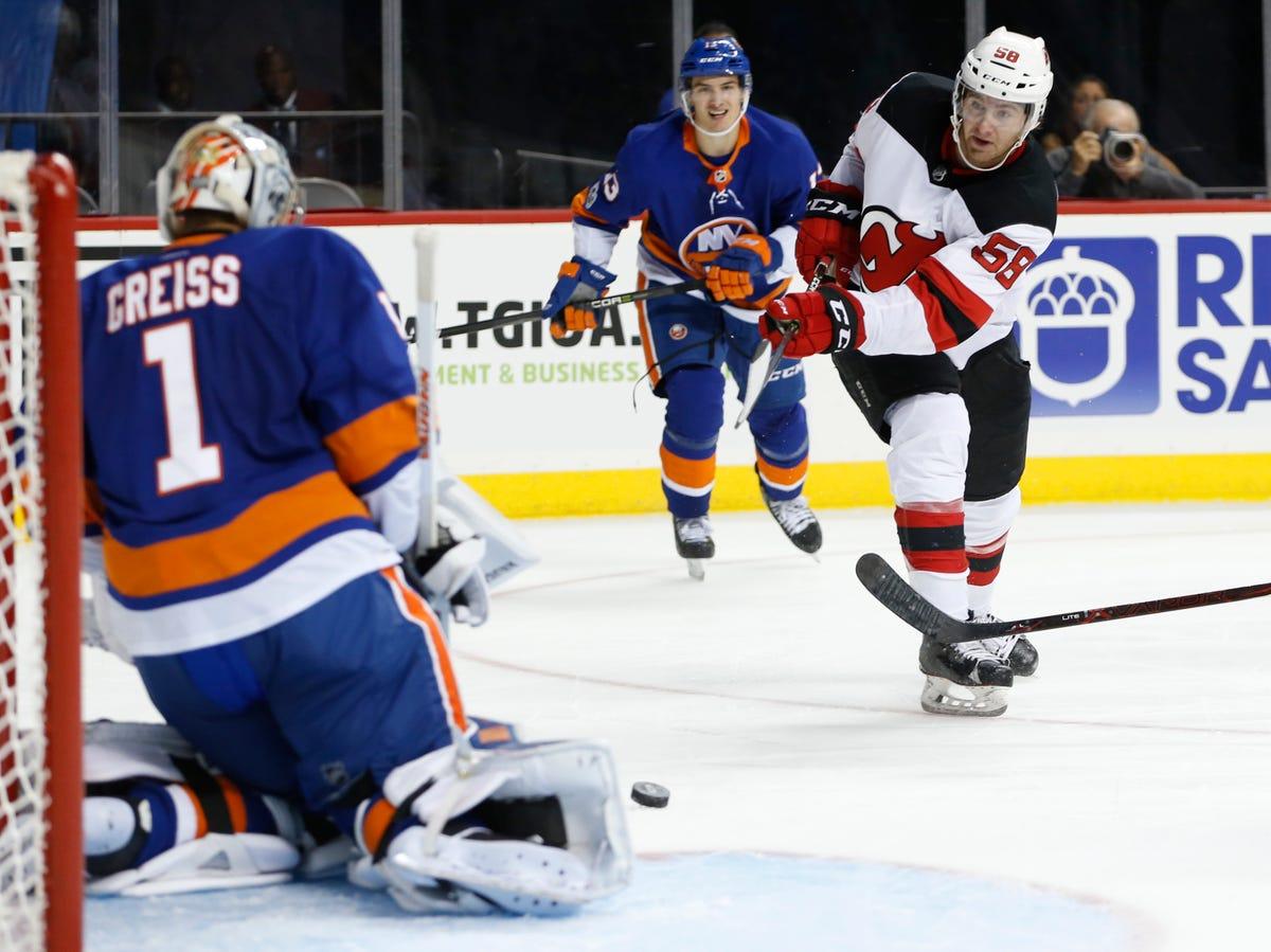 best website e68f2 660a3 NJ Devils bring back AHL forward Kevin Rooney