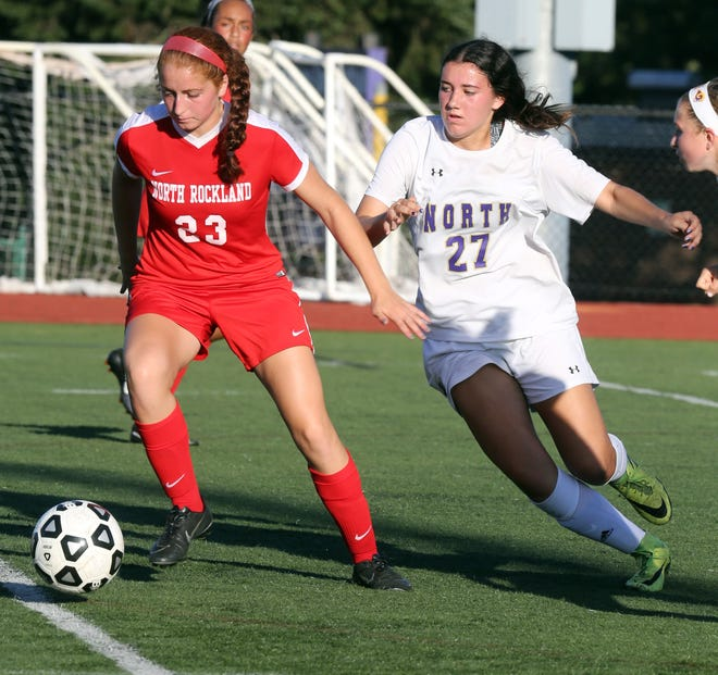 Clarkstown North's Jessica Reck (27) and North Rockland's Olivia Saccado (23) battle for control of the ball during girls soccer game at Clarkstown North high school in New City Sept. 26, 2017. North Rockland defeats Clarkstown North 3-2.