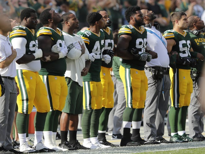The Green Bay Packers are shown during the national anthem before their game against the Cincinnati Bengals  Sunday, Sept. 24, 2017 at Lambeau Field in Green Bay, Wis. NFL players responded in full force Sunday after President Trump repeatedly called for swift punishment against those who chose to protest by not standing during the national anthem. Demonstrations spread throughout the league as many players broke out of their routine by joining the protests or engaging in team-wide displays of unity. Former San Francisco 49ers quarterback Colin Kaepernick began the protests last year by choosing not to stand during the anthem and remains a free agent, said he wanted to speak out against racial injustice and police brutality.   DAN POWERS/APPLETON POST-CRESCENT