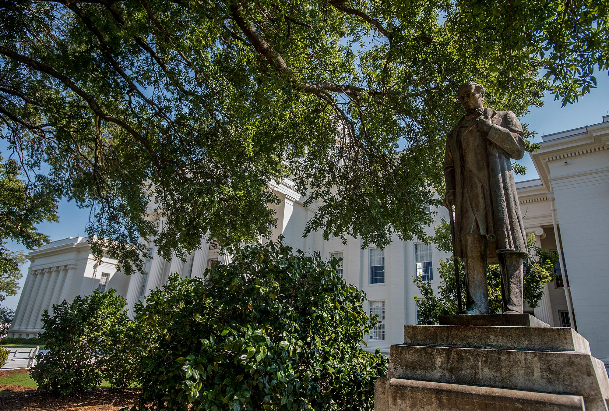 The statue of Dr. James Marion Sims sits in the shade of an old oak tree on the grounds of the state capitol building in Montgomery, Ala. on Friday September 29, 2017.