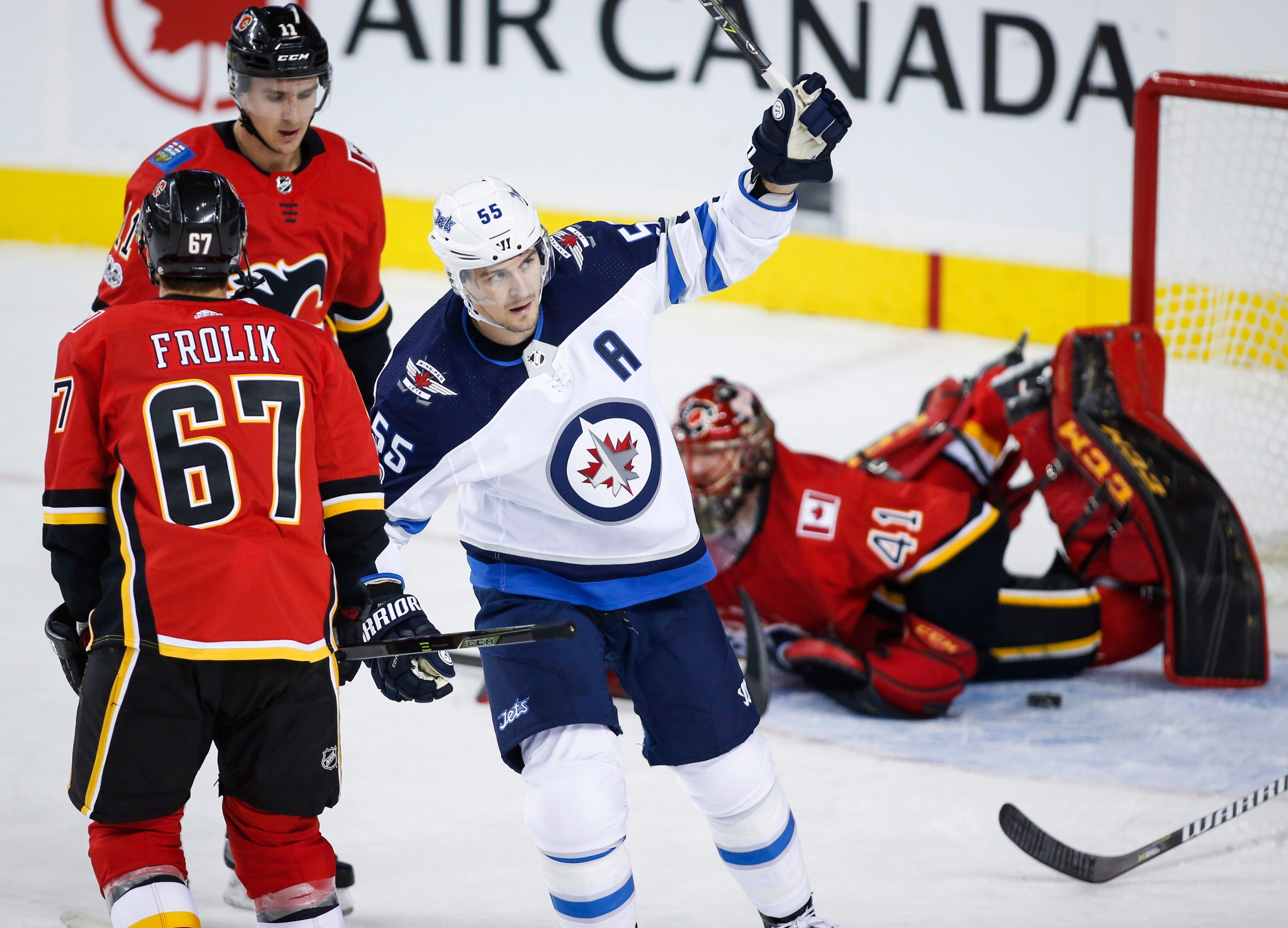 Brodie has 2 goals, 2 assists in Flames' 6-3 win over Jets