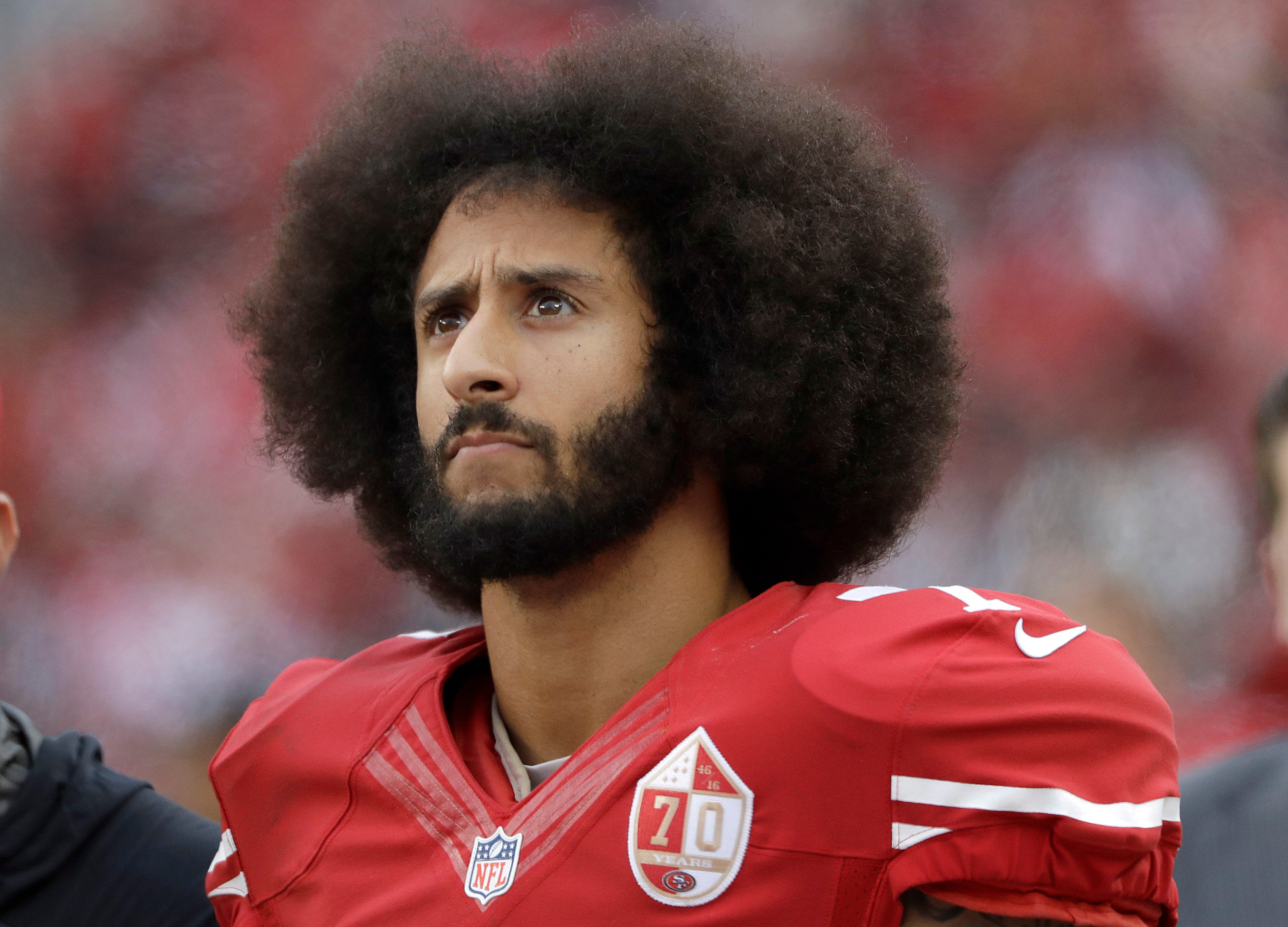 Kaepernick tells CBS he'll stand during national anthem