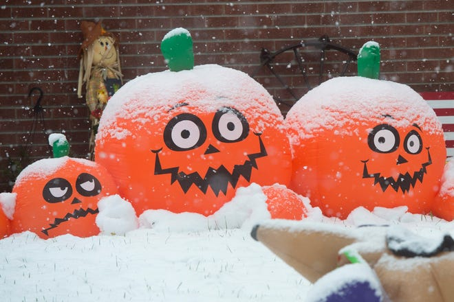 Snow accumulates on Halloween decorations outside a home on Taft Hill Road in Fort Collins on Monday, October 9, 2017. The early season snow has brought less accumulation than expected but a winter storm warning persists through the afternoon for Northern Colorado.