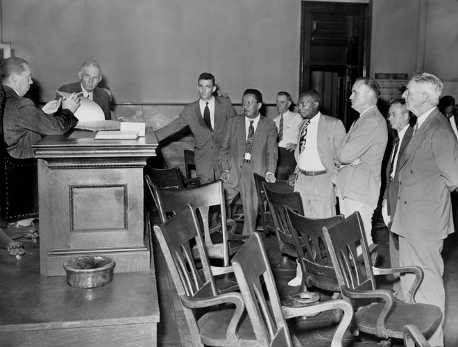 Representatives of the state and defense stand expectantly July 4, 1946, as Judge Joe M. Ingram, left, prepares to hand down one of several decisions in connection with the February racial uprising in Columbia, Tenn. Waiting are Maurice Weaver, left in front of the bench, former Chattanooga CIO leader and attorney for the NAACP, which is providing defense counsel; Dr. L.A. Ransom, legal staff of NAACP in Washington D.C.; Z. Alexander Looby, Nashville attorney; District Attorney General Paul Bumpus; Howard Fish, Nashville court reporter employed by the defense; and Attorney Hugh Todd Shelton Sr. of Columbia, who assisted the state in the case.